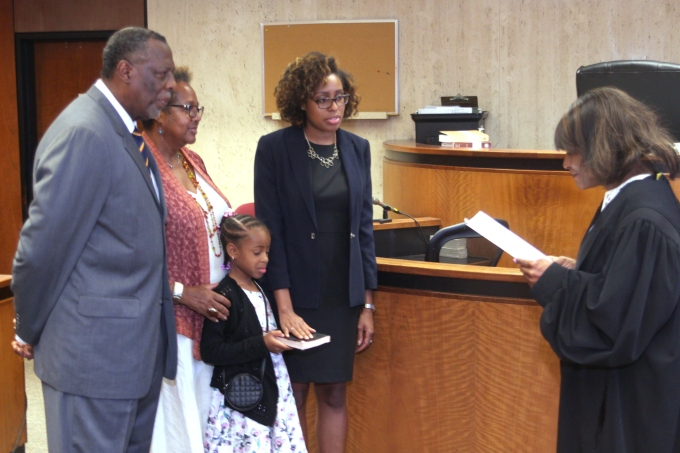 The author with her daughter and parents on the day of her swearing-in as an attorney